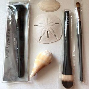 Elf, NYX and Vasanti makeup brushes